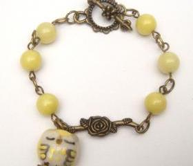 Antiqued Brass Branch Porcelain Owl Jade Bracelet