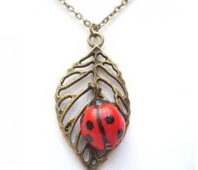 Antiqued Brass Leaf Porcelain Ladybug Necklace