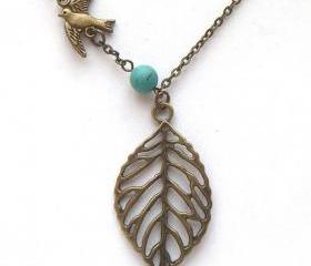 Antiqued Brass Leaf Turquoise Bird Necklace